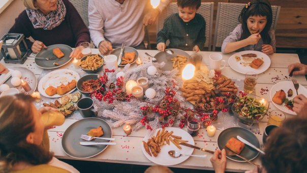 Photo of a multi-generation family having Thanksgiving dinner